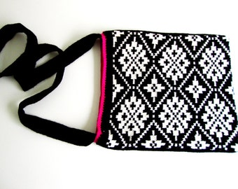 handmade knitted bag in a black and withe jacquard star pattern