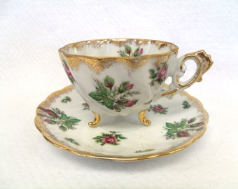 Relco Teacup and Saucer, Japan, Pink Rose Buds, Tri-footed, Gold Embellishments