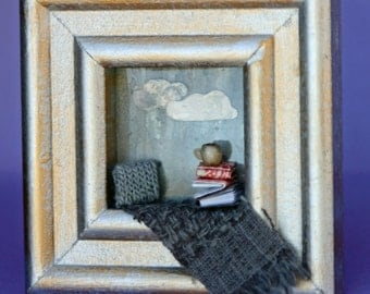Little window diorama, shadow box, rainy day, picture frame, window sill, tea, grey, pillow and blankets, reading, books, square, miniature