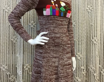 Precious 1970's bohemian knit dress with crewel embroiderery of a town scene