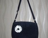 Navy blue corduroy shoulder bag with adjustable cross-body strap and ribbon trim.