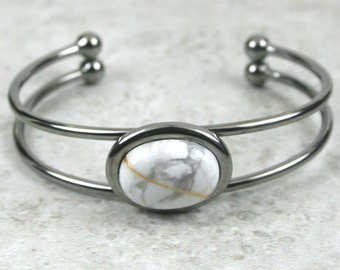 Kintsugi (kintsukuroi) cuff bracelet with white howlite stone cabochon with gold repair in a gunmetal plated setting - OOAK