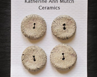 A set of 4 small ceramic buttons, thumb print.  20mm.