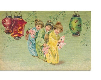 antique postcard of Little girls dressed in kimonos with Japanese lanterns