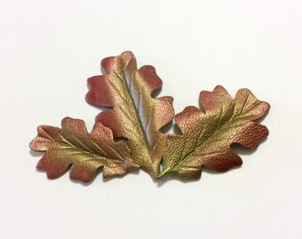 "Two 1"" shaded oak metallic leather leaves."