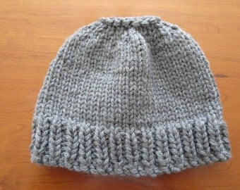 Hand knit woman's s dark grey 100% thick wool pony tail or messy bun hat
