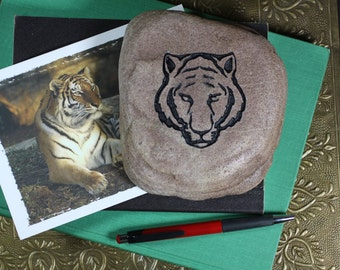 Tiger engraved stone