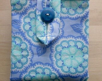 Fabric tea bag holder made of blue and cream fabric.