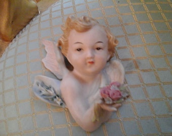 Vintage cherub girl with roses wall hanging