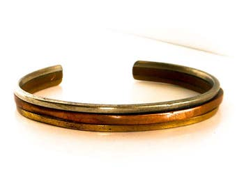 Vintage Copper Cuff Bracelet    Silver plate, Brass and copper   Size 2 3/4 by 2    Fits small to Medium wrist