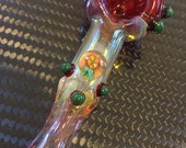 FLOWER Glass pipe  Flower millie with red highlights. Fumed with silver and gold, color changing. Awesome piece