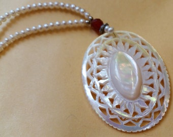 Carved Mother of Pearl Pendant and Seed Pearl Necklace with Sterling Silver Clasp