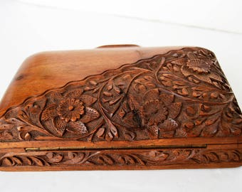 Vintage handmade wooden box with carved flowers