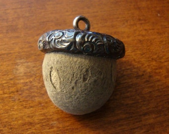 Sterling Silver capped acorn emery