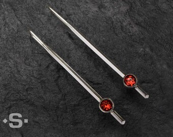 Contemorary Earrings. Sterling Silver and red Almandine Garnets.