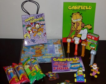 Vintage Garfield Collection Pez Books Wrapping Paper Band Aids etc.