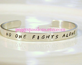 No one fights alone. Hand stamped cuff bracelet. Cancer awareness and support for each other.