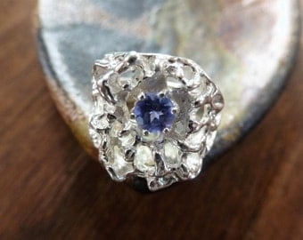 Silver Web Iolite Ring is a openwork chunky sterling silver size 9, set with a brilliant cut Iolite for sparkle.