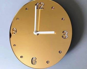 "Round Gold Mirror & White Clock - White Acrylic Back, Gold Mirror Finish Acrylic with White hands, Silent Sweep Movement.  Sizes 8"" or 12"""