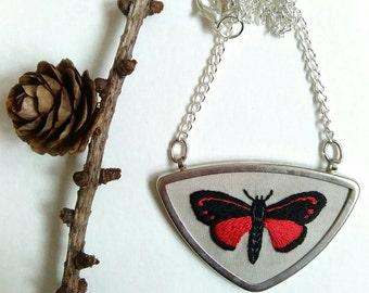 Hand embroidered cinnabar moth pendant