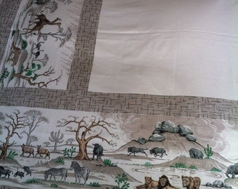 An African Wildlife Safari Theme Tablecloth That Measures 53 in x 50 in