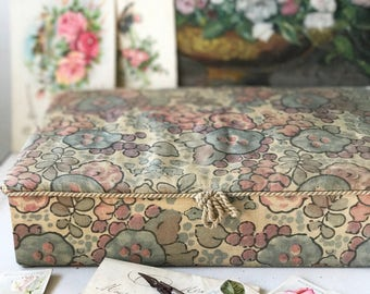 A beautiful vintage French fabric covered box