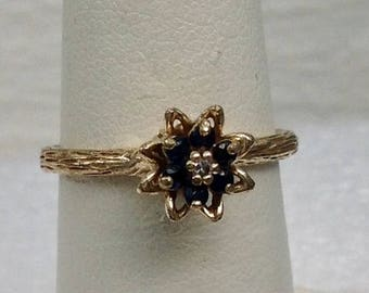 Vintage flower and branch motief 10kt gold sapphire and diamond ring.