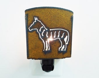 Zebra Night Light Image made out of rusted metal