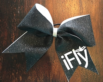 Glitter cheer bow with saying on a hair elastic