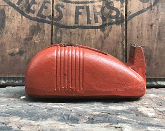 antique scotch tape dispenser ~ burnt orange cast iron tape dispenser with art deco lines ~ small cast iron tape dispenser