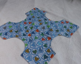 reversible table topper / center piece / bread wrap made from a blue heart print and blue tonal cotton fabric