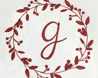 Whimsical wreath with flowers and berries machine embroidery design.  Perfect for adding an initial or a monogram.  4 sizes.