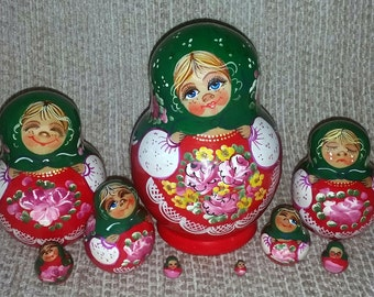 Girl in Different Moods on Nine Russian Nesting Dolls.