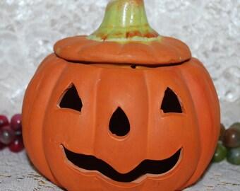 "K's Collection Labeled Orange Terracotta 4-1/2"" Carved Face Lidded Pumpkin"