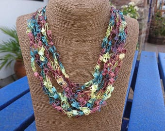 Crochet multistrand necklace with tassle. Can be worn 2ways