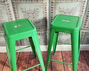 Green metal Tolix style bar stools