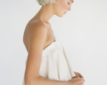 Poppy // A strapless, layered dress with a peplum top and ruched circle skirt