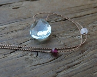 Aquamarine necklace. Everyday necklace with aquamarine briolette, garnet and moonstone beads on a thin light brown silk thread