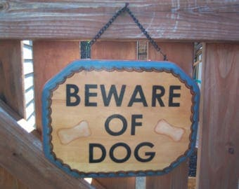 Beware of Dog Sign Painted on Wood with Rust and Blue Colors and Bones