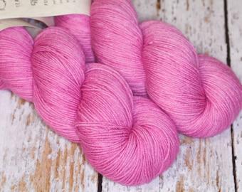 Hand Dyed KM Fingering Sock Yarn Superwash Merino Wool Nylon in Raspberry Pink Monochrome