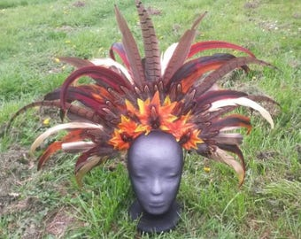 Feather Headdress with pheasant, rooster and gold feathers.