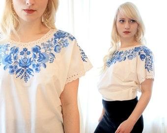 Vintage white cotton eyelet folk blouse with indigo blue floral embroidery mexican or european style