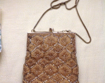 Awesome vintage evening bag....gold beaded with snake chain.....silky interior....great condition