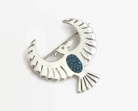 Native American sterling silver brooch of eagle with mosaic inlay of turquoise chips, faintly stamped 925 for sterling silver, 12 grams