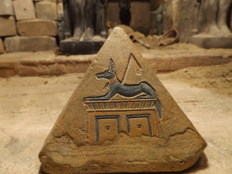 Egyptian pyramid sculpture art featuring bast khonsu