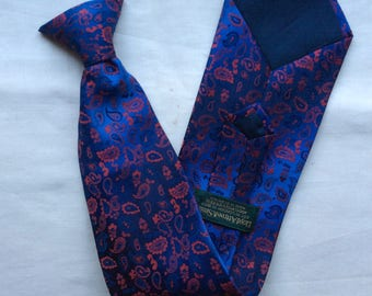 Vintage clip on red on blue Paisley patterned  tie. Made in Britain.