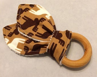 Natural maple wooden teething ring with brown moose print fabric