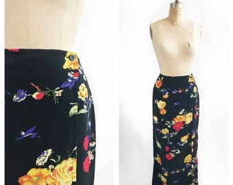 Black floral maxi wrap skirt with side slits. Size S.