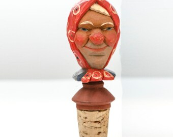 Austrian carved wood woman in red scarf bottle stopper