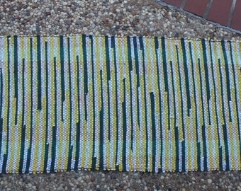 """Handwoven rag rug variegated green and yellow. 20"""" x 39"""""""